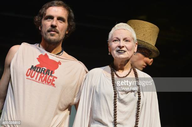 Andreas Kronthaler and designer Vivienne Westwood acknowledge the audience after the show for fashion house Vivienne Westwood as part of the Menswear...