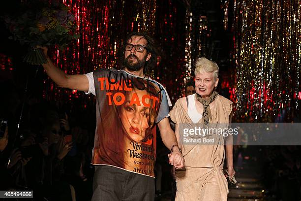 Andreas Kronthaler and Vivienne Westwood acknowledge the audience on the runway after the Vivienne Westwood show as part of the Paris Fashion Week...