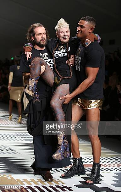 Andreas Kronthaler Dame Vivienne Westwood and a model walk the runway at the Fashion For Relief charity fashion show to kick off London Fashion Week...