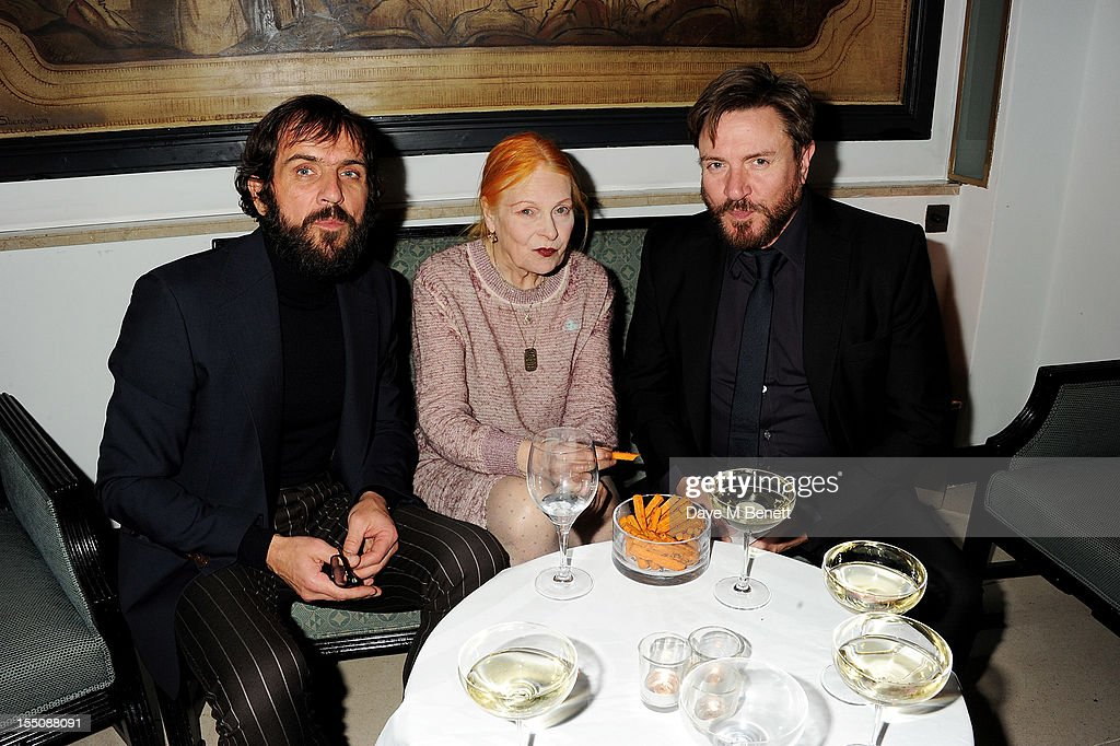 (MANDATORY CREDIT PHOTO BY DAVE M BENETT/GETTY IMAGES REQUIRED) (L to R) Andreas Kronthaler, Dame Vivienne Westwood and Simon Le Bon attend the Harper's Bazaar Women of the Year Awards 2012, in association with Estee Lauder, Harrods and Tiffany & Co., at Claridge's Hotel on October 31, 2012 in London, England.