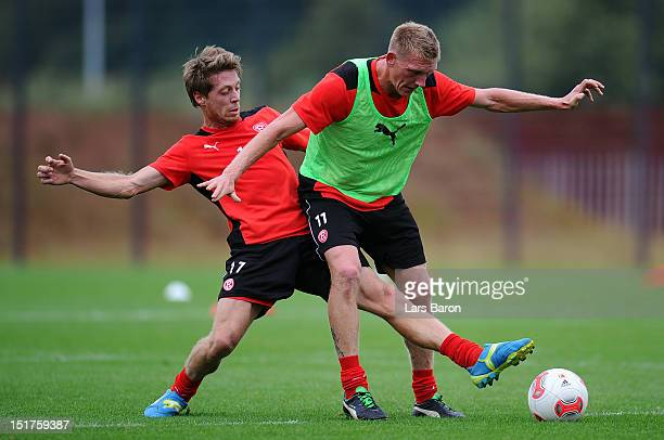Andreas Lambertz challenges Axel Bellinghausen during a Fortuna Duesseldorf training session on September 11 2012 in Duesseldorf Germany