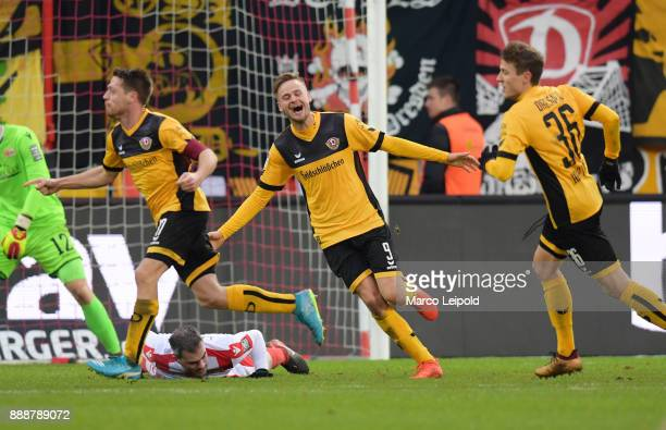 Andreas Lambertz Lucas Roeser and Niklas Hauptmann of SG Dynamo Dresden celebrate after scoring the 01 goal during the Second Bundesliga match...