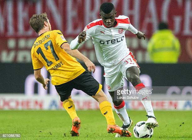 Andreas Lambertz of Dresden and Ihlas Bebou of Duesseldorf in action during the Second Bundesliga match between Fortuna Duesseldorf and SG Dynamo...