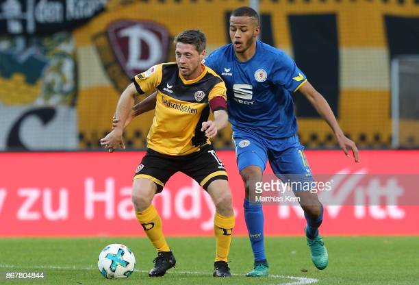 Andreas Lambertz of Dresden battles for the ball with Louis Samson of Braunschweig during the Second Bundesliga match between SG Dynamo Dresden and...