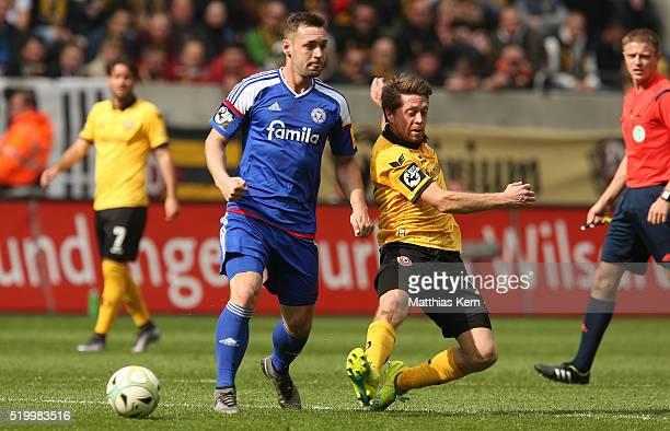 Andreas Lambertz of Dresden battles for the ball with Maik Kegel of Kiel during the third league match between SG Dynamo Dresden and Holstein Kiel at...