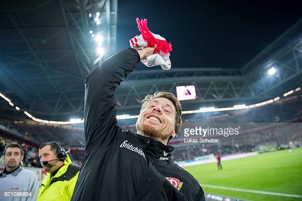 Andreas Lambertz of Dresden catches a scarf of his old club Duesseldorf after the Second Bundesliga match between Fortuna Duesseldorf and SG Dynamo...