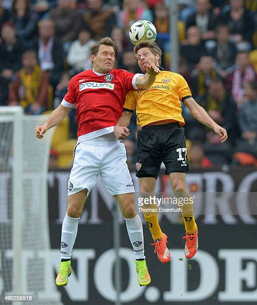 Andreas Lambertz of Dresden is challenged by Robert Mueller of Aalen during the Third League match between SG Dynamo Dresden and VfR Aalen at Stadion...
