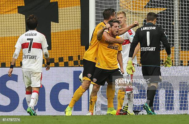 Andreas Lambertz of Dresden jubilates with team mates after scoring the second goal during the Second Bundesliga match between SG Dynamo Dresden and...