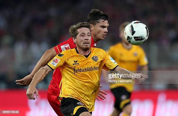 Andreas Lambertz of Dresden vies with Fabian Schoenheim of Berlin during the Second Bundesliga match between 1 FC Union Berlin and SG Dynamo Dresden...