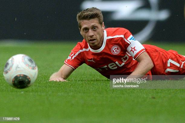 Andreas Lambertz of Duessdorf lies on the field during the Second Bundesliga match between Fortuna Duesseldorf and 1860 Muenchen at Esprit Arena on...