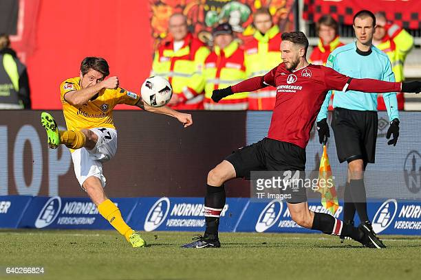 Andreas Lambertz of Dynamo Dresden and Tim Matavz of FC Nuernberg battle for the ball during the Second Bundesliga match between 1 FC Nuernberg and...