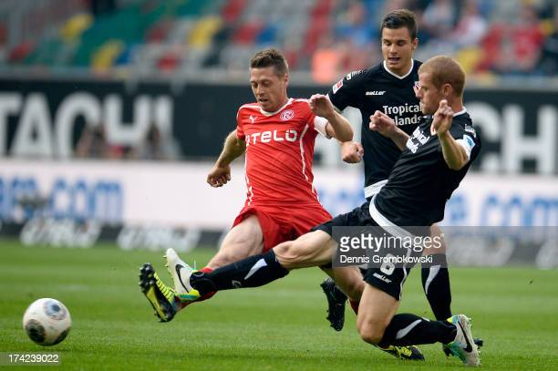 Andreas Lambertz of Fortuna Duesseldorf is challenged by Uwe Moehrle of Energie Cottbus during the Second Bundesliga match between Fortuna...