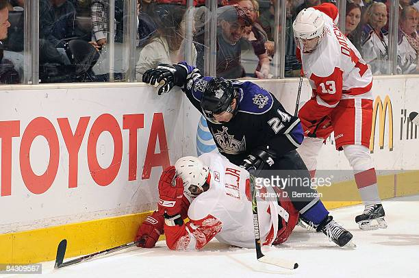 Andreas Lilja of the Detroit Red Wings slams into the boards with Alexander Frolov of the Los Angeles Kings during the game at Staples Center January...
