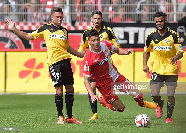 Andreas Ludwig Damir Kreilach of 1 FC Union Berlin Fabio Kaufmann and Phil OfosuAyeh of VfR Aalen during the game between Union Berlin and VfR Aalen...