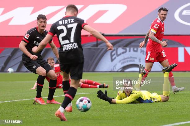 Andreas Luthe of 1. FC Union Berlin reacts as Florian Wirtz of Bayer 04 Leverkusen scores their side's first goal during the Bundesliga match between...