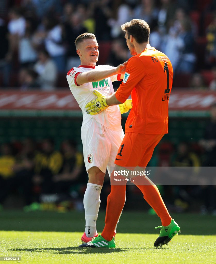 Andreas Luthe of Augsburg celebrates with Philipp Max of Augsburg after the first goal during the Bundesliga match between FC Augsburg and Borussia Dortmund at WWK Arena on May 13, 2017 in Augsburg, Germany.