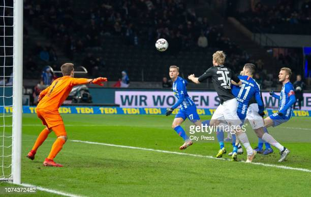 Andreas Luthe of FC Augsburg Maximilian Mittelstaedt of Hertha BSC Martin Hinteregger of FC Augsburg Mathew Leckie and Fabian Lustenberger of Hertha...