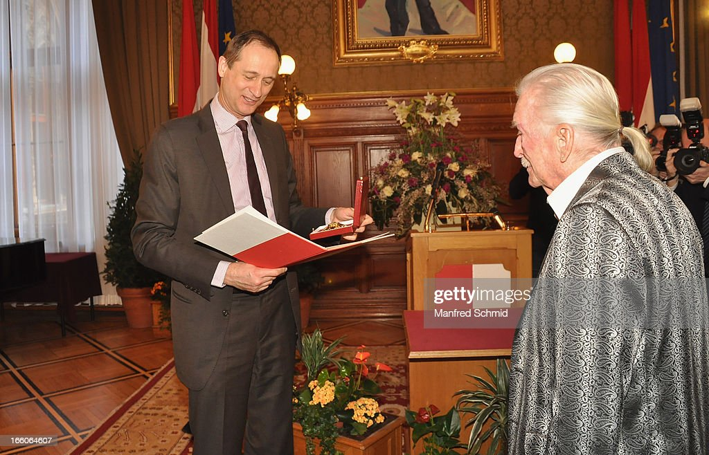 Andreas Mailath-Pokorny presents James Last with his 'Goldenes Ehrenzeichen fuer Verdienste um das Land Wien' given in the Rathaus Wien on April 8, 2013 in Vienna, Austria.