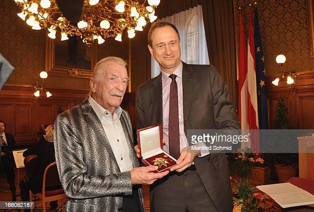 Andreas MailathPokorny presents James Lastwith the 'Goldenes Ehrenzeichen fuer Verdienste um das Land Wien' given in the Rathaus Wien on April 8 2013...