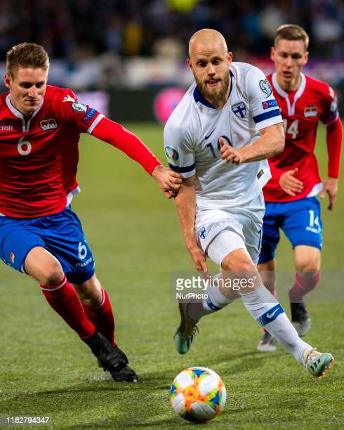 Andreas Malin and Teemu Pukki fight for the ball during the UEFA Euro 2020 Qualifier between Finland and Liechtenstein on November 15, 2019 in...