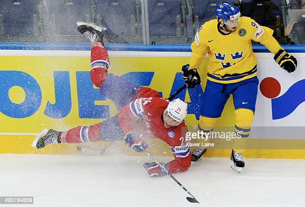 Andreas Martinsen of Norway and Niclas Andersen of Sweden in action during the 2014 IIHF World Championship between Sweden and Norway at Chizhovka...