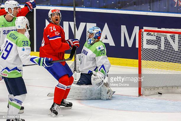 Andreas Martinsen of Norway celebrates goal of his teammate Patrick Thoresen during the IIHF World Championship group B match between Slovenia and...