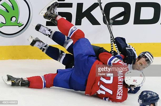 Andreas Martinsen of Norway slashed Karol Sloboda of Slovakia during the 2014 IIHF World Championship between Slovakia and Norway at Chizhovka arena...