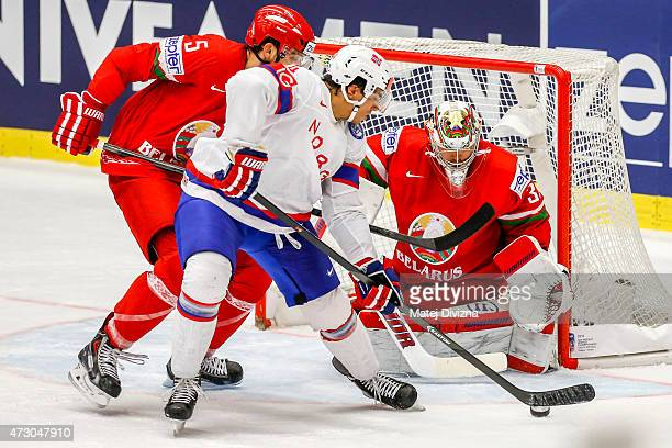 Andreas Martinsen of Norway tries to score against Kevin Lalande goalkeeper of Belarus during the IIHF World Championship group B match between...