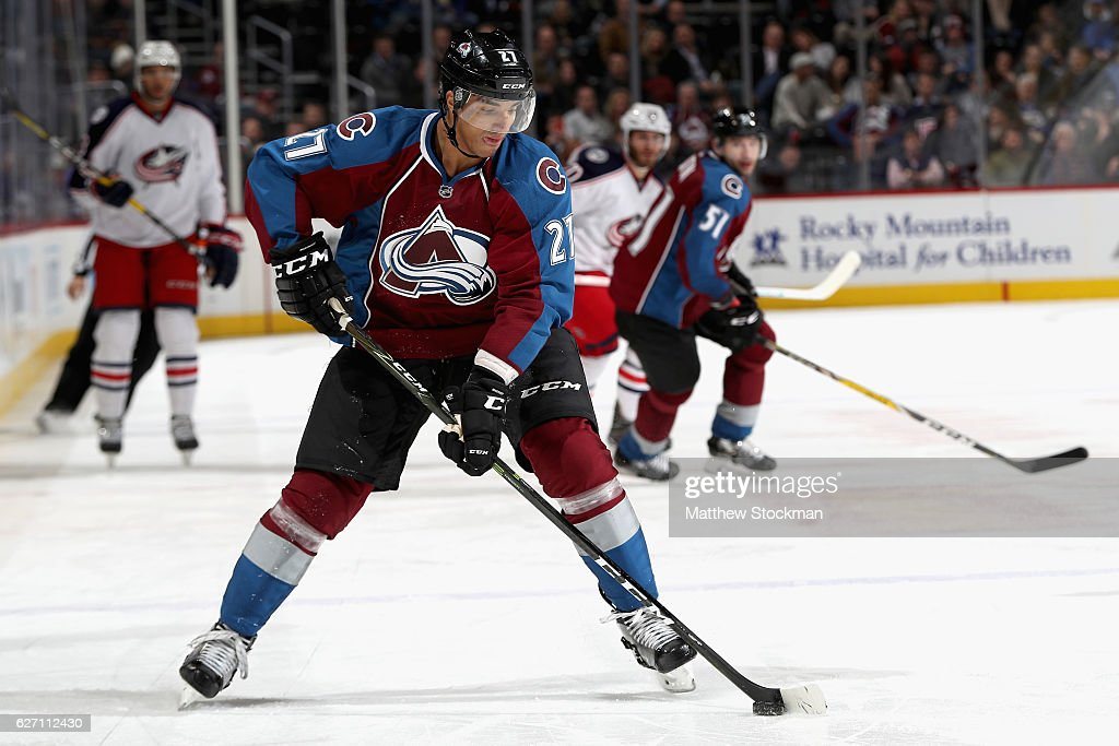 Andreas Martinsen #27 of the Colorado Avalanche advances the puck against the Columbus Blue Jackets at the Pepsi Center on December 1, 2016 in Denver, Colorado.