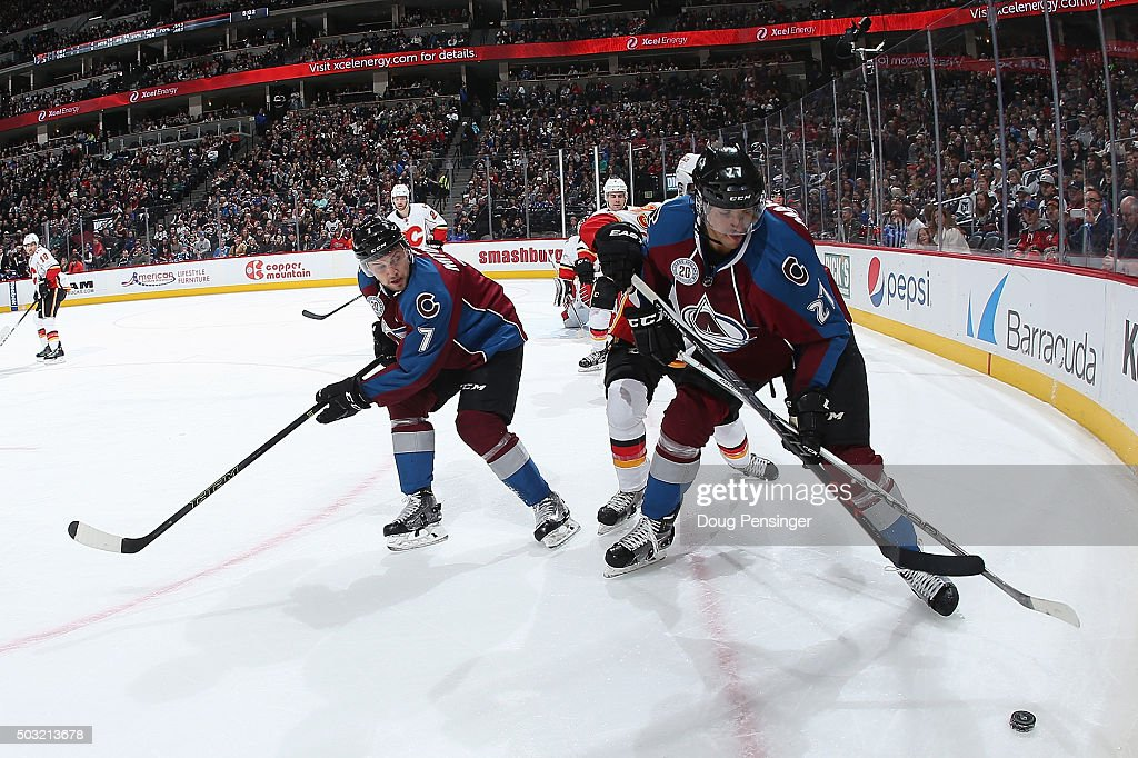 Andreas Martinsen #27 of the Colorado Avalanche and John Mitchell #7 of the Colorado Avalanche look to control the puck against the Calgary Flames at Pepsi Center on January 2, 2016 in Denver, Colorado. The Flames defeated the Avalanche 4-0.