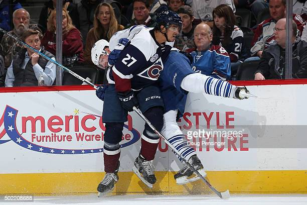Andreas Martinsen of the Colorado Avalanche puts a hit on Dion Phaneuf of the Toronto Maple Leafs at Pepsi Center on December 21 2015 in Denver...
