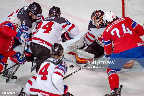 Andreas Martinsen tries to score against Goalie Chad Johnson during the Ice Hockey World Championship between Canada and Norway at AccorHotels Arena...