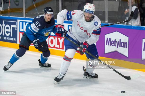 Andreas Martinsen vies with Ville Lajunen during the Ice Hockey World Championship between Norway and Finland at AccorHotels Arena in Paris France on...