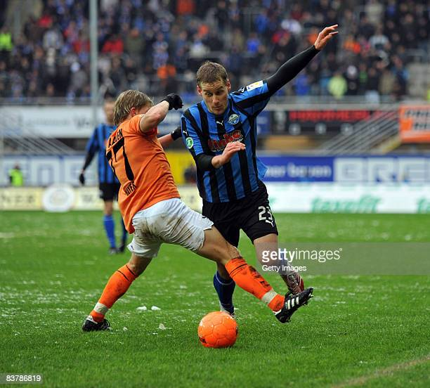 Andreas Mayer of Aalen challenges Soeren Halfar of Paderborn during the 3 Bundesliga match between SC Paderborn and VFR Aalen at the Paragon Arena on...