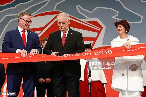Andreas Meyer CEO of Swiss Federal Railways SBB AG Swiss Federal President Johann SchneiderAmmann and Swiss Federal Councillor Doris Leuthard cut the...