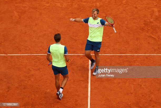 Andreas Mies and Kevin Krawietz of Germany celebrate after winning match point during their Men's Doubles quarterfinals match against Jamie Murray...