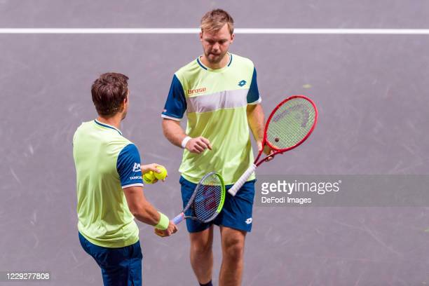 Andreas Mies of Germany and Kevin Krawietz of Germany look on during day seven of the Bett1Hulks Championship tennis tournament at Lanxess Arena on...
