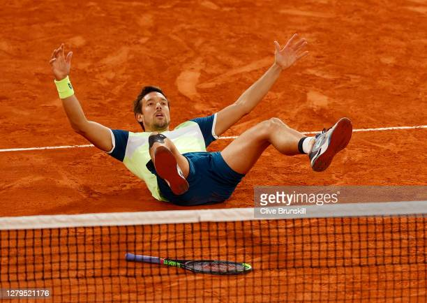 Andreas Mies of Germany celebrates after winning championship point in his Men's Doubles Final with partner Kevin Krawietz on Court Philippe-Chatrier...