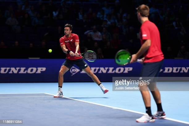 Andreas Mies of Germany playing partner of Kevin Krawietz of Germany plays a backhand in their doubles match against JeanJulien Rojer of The...