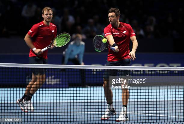 Andreas Mies of Germany playing partner of Kevin Krawietz of Germany plays a forehand at the net in their doubles match against JeanJulien Rojer of...