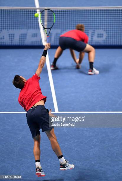 Andreas Mies of Germany playing partner of Kevin Krawietz of Germany serves in their doubles match against Nicolas Mahut and PierreHugues Herbert of...