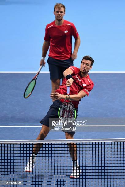 Andreas Mies of Germany playing partner of Kevin Krawietz of Germany plays a forehand volley in their doubles match against Nicolas Mahut and...