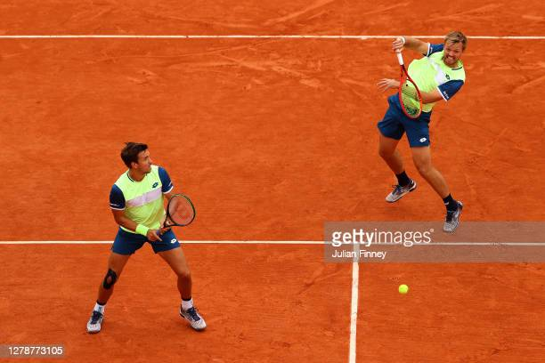 Andreas Mies of Germany plays a forehand during his Men's Doubles quarterfinals match with partner Kevin Krawietz of Germany against Jamie Murray and...