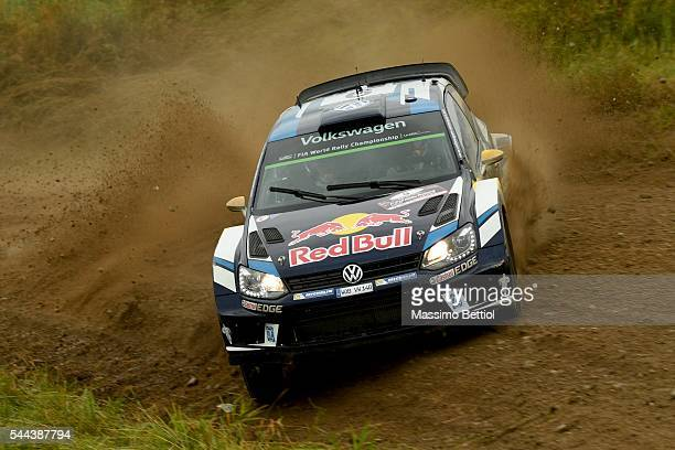 Andreas Mikkelsen of Norway and Anders Jaeger of Norway compete in their Volkswagen Motorsport II Volkswagen Polo R WRC during Day Three of the WRC...