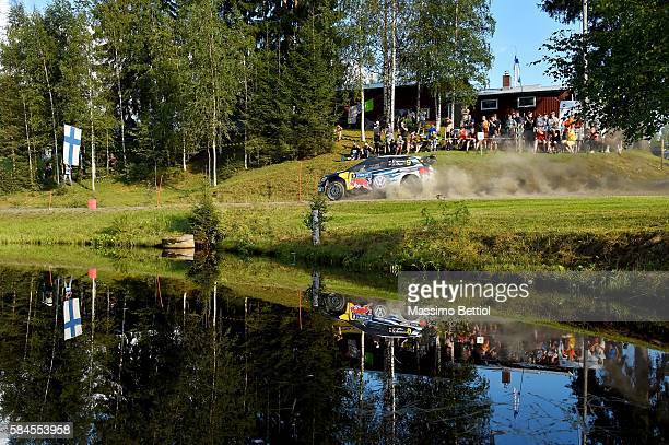 Andreas Mikkelsen of Norway and Anders Jaeger of Norway compete in their Volkswagen Motorsport II Volkswagen Polo R WRC during Day One of the WRC...