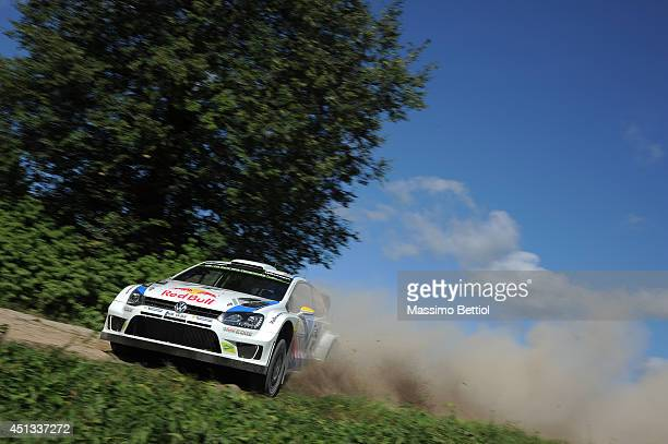 Andreas Mikkelsen of Norway and Ola Floene of Norway compete in their Volkswagen Motorsport II Polo R WRC during Day One of the WRC Poland on June 27...