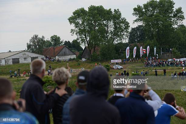 Andreas Mikkelsen of Norway and Ola Floene of Norway compete in their Volkswagen Motorsport II Polo R WRC during Day Three of the WRC Poland on June...