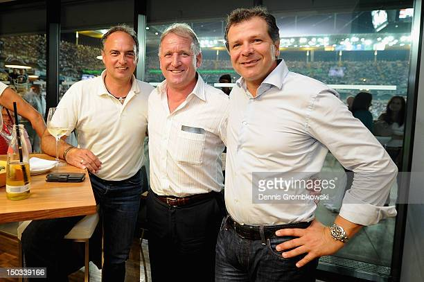 Andreas Moeller Andreas Brehme and Hansi Mueller pose during the Club of former national players meeting at the friendly match between Germany and...