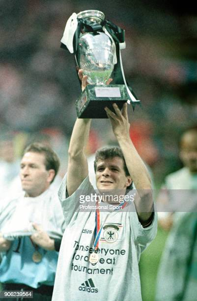 Andreas Moller of Germany holds the trophy aloft following the UEFA Euro96 final at Wembley Stadium in London on 30th June 1996 Germany won 21 after...