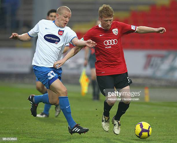 Andreas Neuendorf of Ingolstadt battles for the ball with Richard Weil of Heidenheim during the 3.Liga match between FC Ingolstadt and 1. FC...